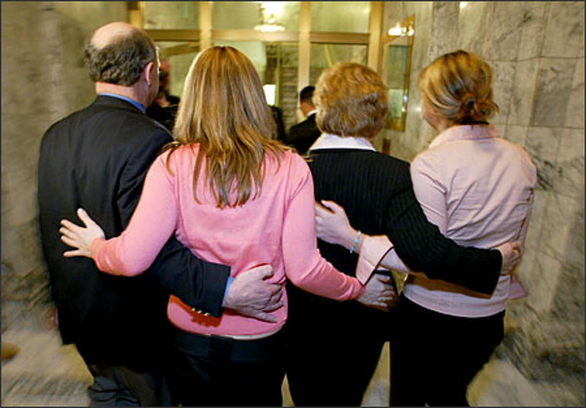 Christine Gregoire with her husband Mike, and daughters Courtney and Michelle exit a press conference in Olympia after expressing her gratitude for being in the lead of the governor's race.