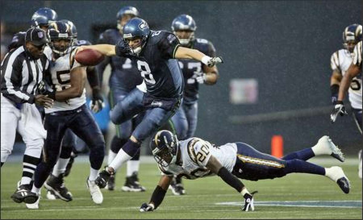 Seahawks quarterback Matt Hasselbeck (8) leaps over San Diego Chargers safety Marlon McCree (20) for a 10-yard gain during the fourth quarter of the Dec. 24 game. The Seahawks lost 20-17.