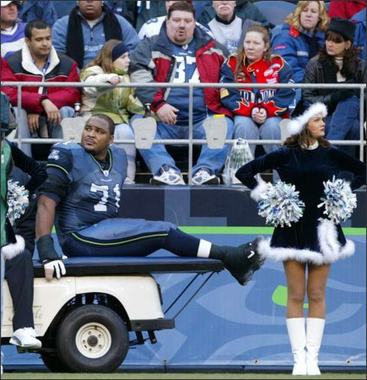 Seahawks Pro Bowl offensivie tackle Walter Jones is carted off the field after twisting his left ankle during the third quarter of the Hawks' game against the Arizona Cardinals.