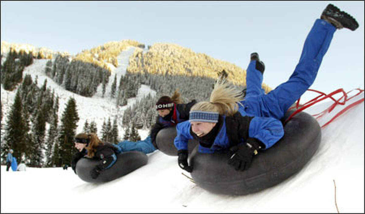 Tiffany Widing, right, of Edmonds hit one of the hills at the Stevens Pass ski area with friends.