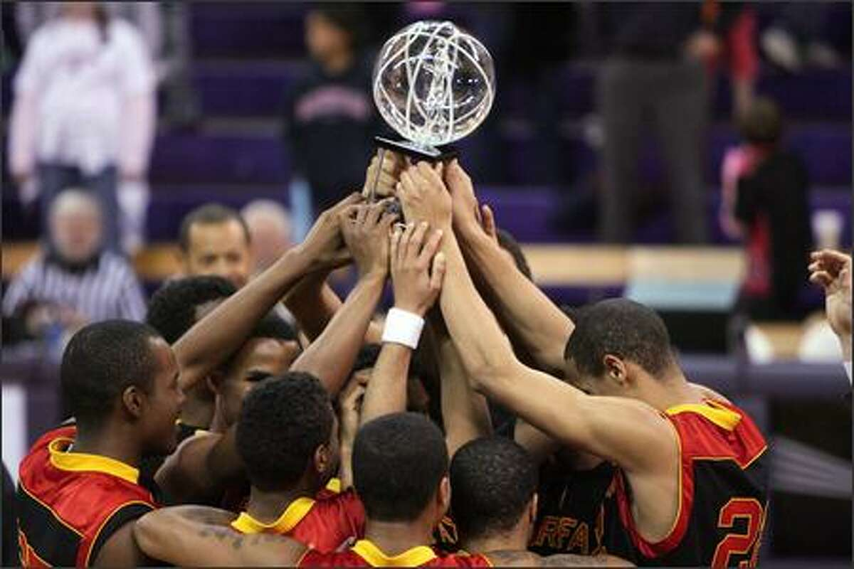 Members of the Lions basketball team from Fairfax High School in Los Angeles hold up their trophy after winning the T-Mobile Invitational National High School Basketball Tournament at Hec Edmundson Pavilion at the University of Washington. Fairfax beat Laflore High School from Mobile, Ala., 52-42 to take the championship.