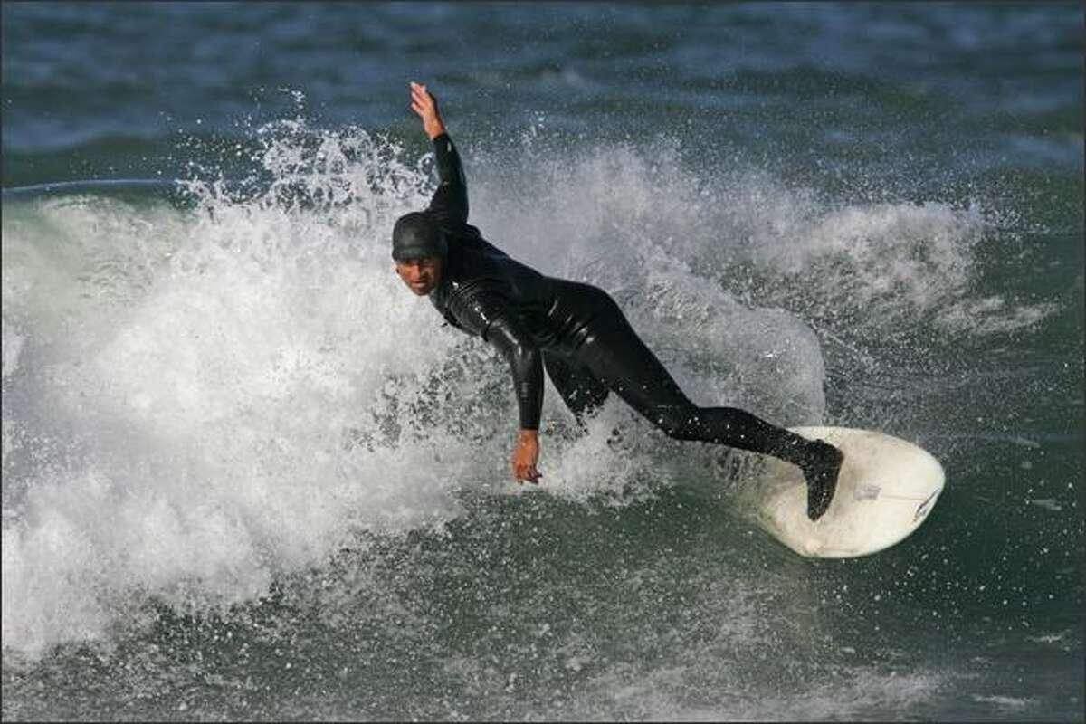 Surf shop owner and local ripper Matt Loughran surfs in Westport, WA.