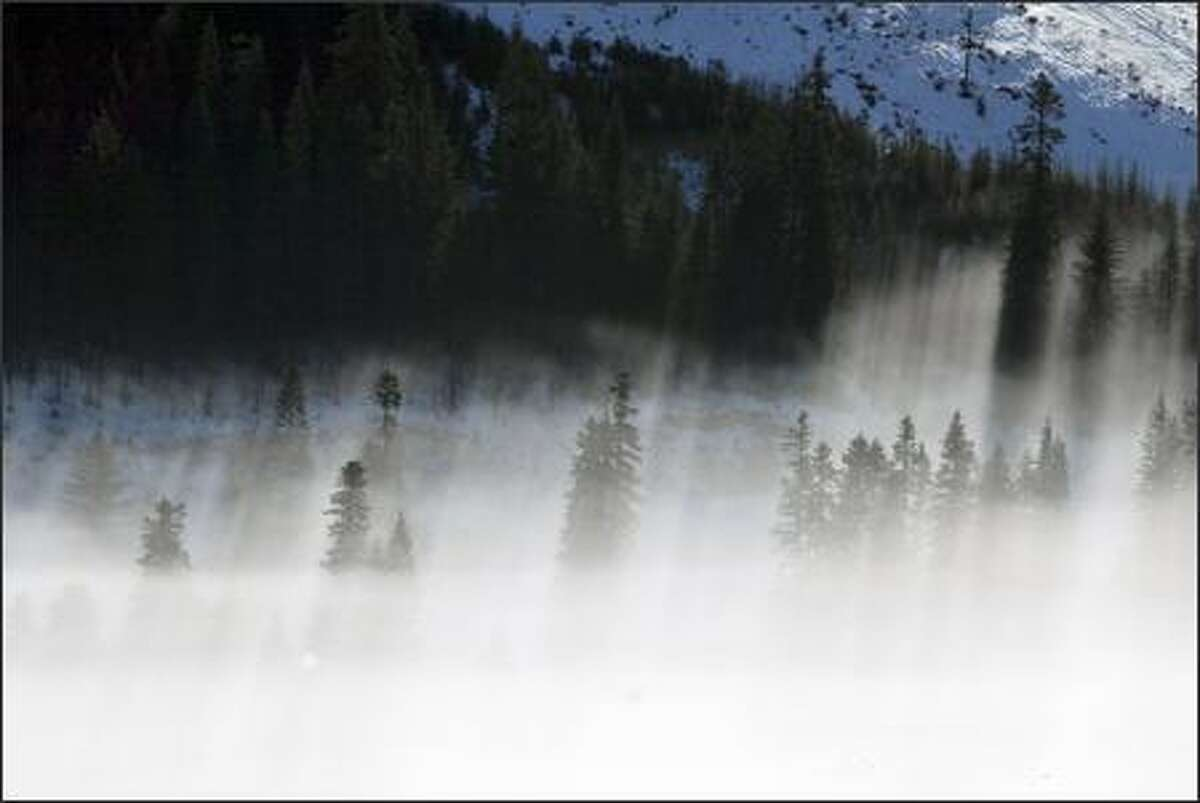 Fog blankets the Stevens Pass area as the snowshoers make their ascent to Skyline Lake. The considerably demanding trek gains about 1,300 feet of elevation.