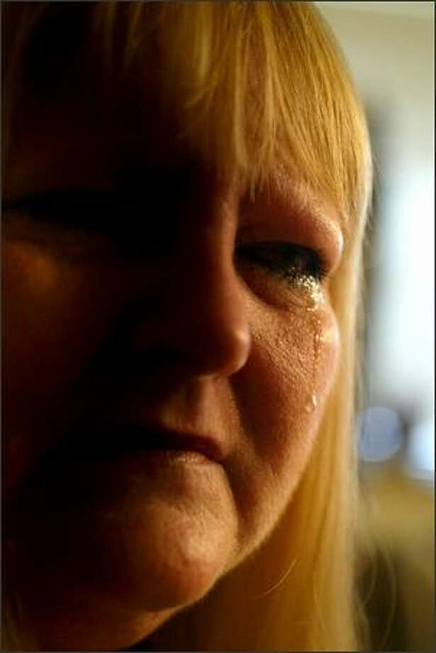 Brenda Lee sheds a tear as she remembers her son, Jared Dahl-Lee, who was shot dead after a confrontation with another motorist in September. Photo: Karen Ducey, Seattle Post-Intelligencer / Seattle Post-Intelligencer