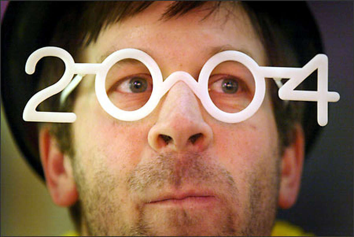 Mike J. Fischer sports a pair of 2004 glasses at the Seattle Center as the clock winds down toward the New Year.