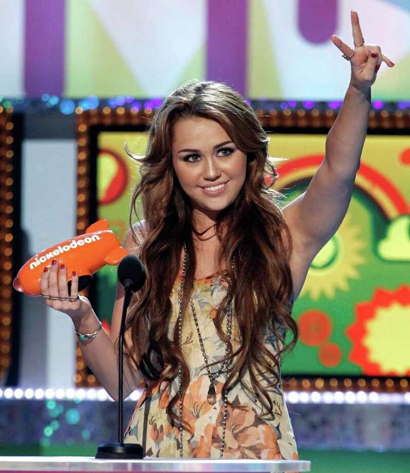 "Miley Cyruskept her hair longer during her stint on her hit show ""Hannah Montana.""   Photo: AP"