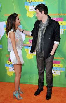 Selena Gomez, left, and Cory Monteith arrive at Nickelodeon's 24th Annual Kids' Choice Awards on Saturday, April 2, 2011, in Los Angeles. Photo: AP