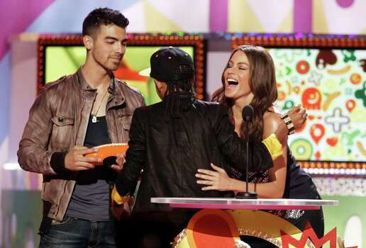 "Joe Jonas, left, and Sofia Vergara congratulate Jaden Smith, center, who accepted for the ""Favorite Movie"" award at Nickelodeon's 24th Annual Kids' Choice Awards on Saturday, April 2, 2011, in Los Angeles. Photo: AP"