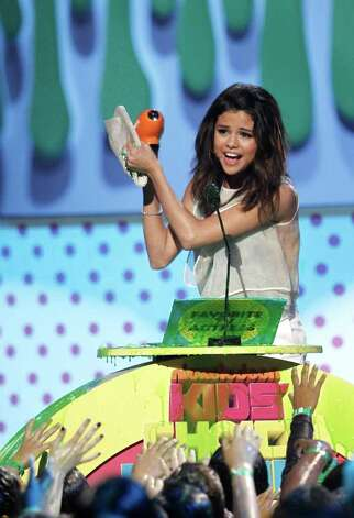 "Actress Selena Gomez accepts the award for ""Favorite TV Actress"" at Nickelodeon's 24th Annual Kids' Choice Awards on Saturday, April 2, 2011, in Los Angeles. Photo: AP"