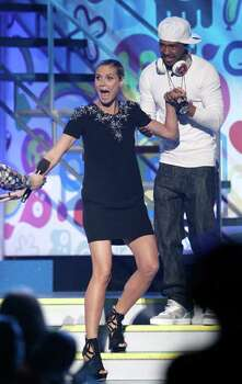 Actress Heidi Klum and singer Nick Cannon walk on stage at Nickelodeon's 24th Annual Kids' Choice Awards on Saturday, April 2, 2011, in Los Angeles. Photo: AP