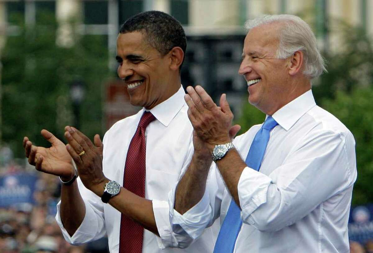 ** FILE ** In this Aug. 23, 2008 file photo, Democratic presidential candidate Sen. Barack Obama D-Ill., and his vice presidential running mate Sen. Joe Biden D-Del. applaud at a campaign stop Saturday, Aug. 23, 2008, in Springfield, Ill. President Obama formally launched his re-election campaign Monday, urging grass-roots supporters central to his first White House run to mobilize again to protect the change he's brought over the past two years. (AP Photo/M. Spencer Green)