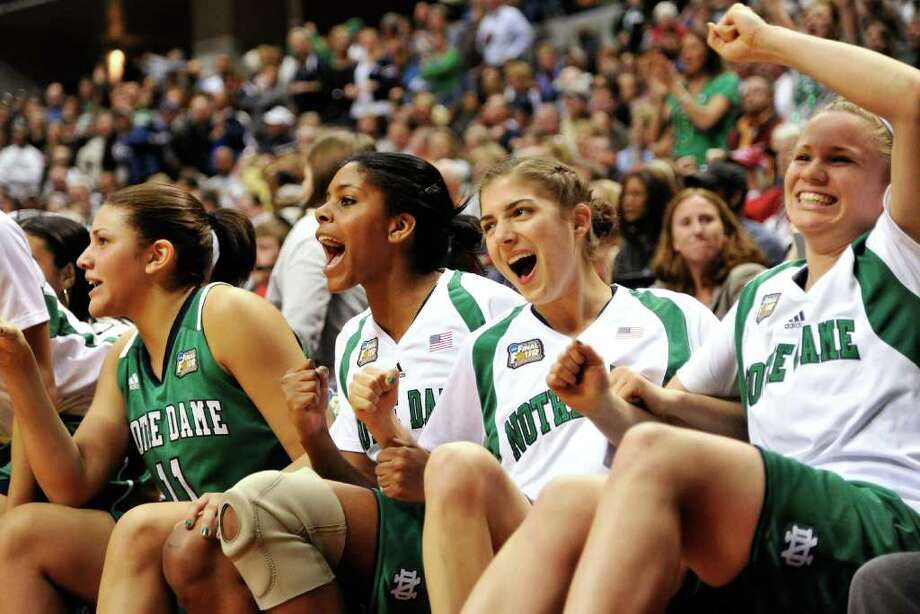 INDIANAPOLIS, IN - APRIL 3:  The Notre Dame Fighting Irish bench erupts with joy as time winds down on their defeat of the Connecticut Huskies during the 2011 NCAA Women's Final Four at Conseco Fieldhouse on April 3, 2011 in Indianapolis, Indiana. Notre Dame defeated Connecticut 72-63.   (Photo by Jamie Sabau/Getty Images) Photo: Jamie Sabau, Getty Images / 2011 Getty Images