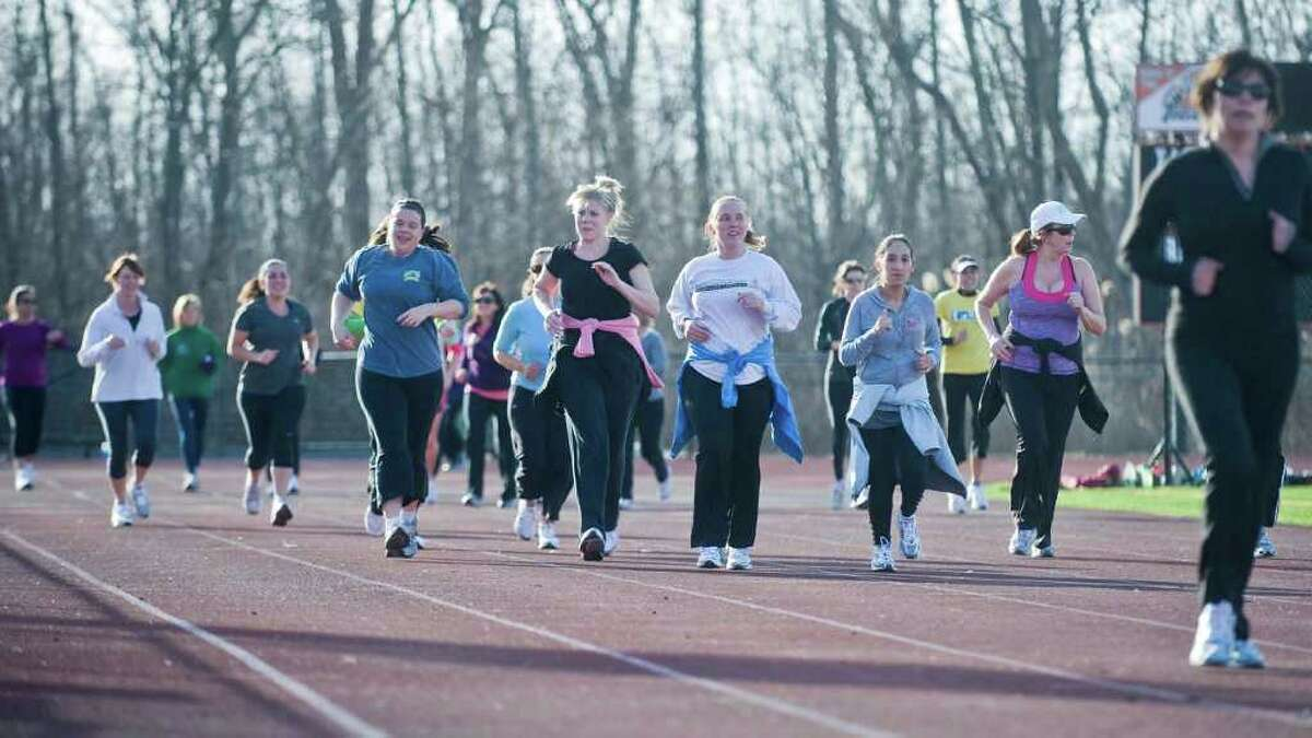 Approximately 70 women runners practice on the Ridgefield High School track for the upcoming Run Like A Mother 5K race. Sunday, April 3, 2011