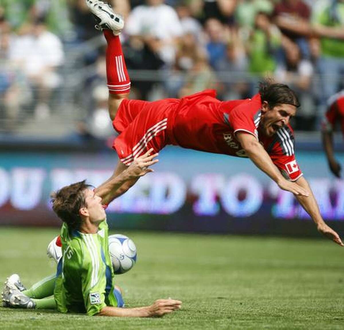 Seattle Sounders player Brad Evans and Toronto FC player Nick Garcia tangle near the Sounders' goal on Saturday August 29, 2009 in the second half of a match at Qwest Field in Seattle.