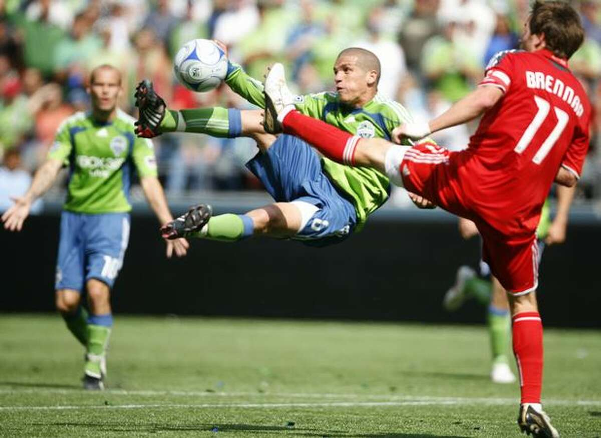 Seattle Sounders player Osvaldo Alonso attempts a goal against Toronto FC player Jim Brennan on Saturday August 29, 2009 in the second half of a match at Qwest Field in Seattle. No goals were scored in the game that ended in a 0-0 draw.