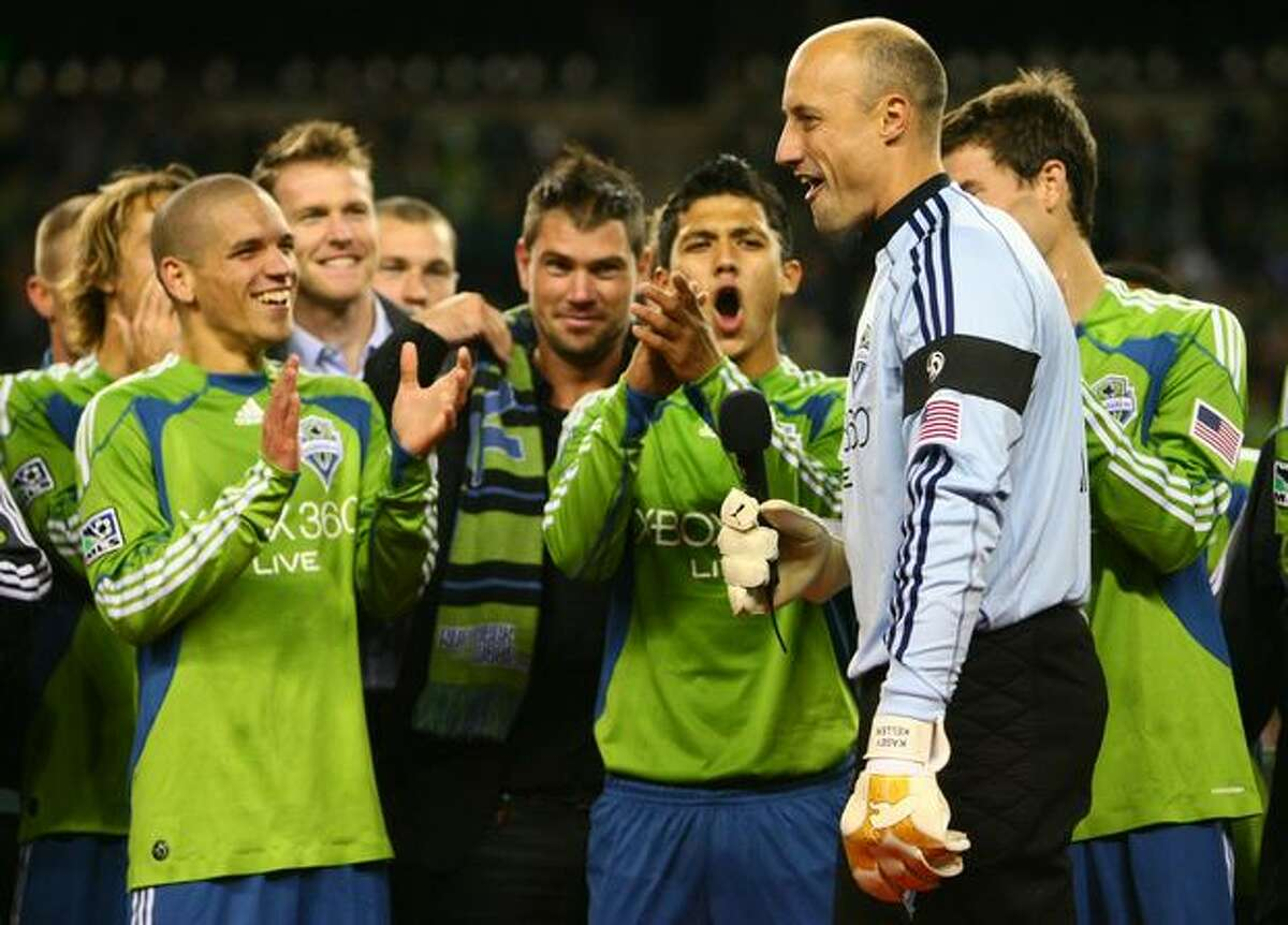 Seattle Sounders players gather around team captain and goalie Kasey Keller after the team defeated FC Dallas and ended regular season home games on Saturday October 24, 2009 at Qwest Field in Seattle.