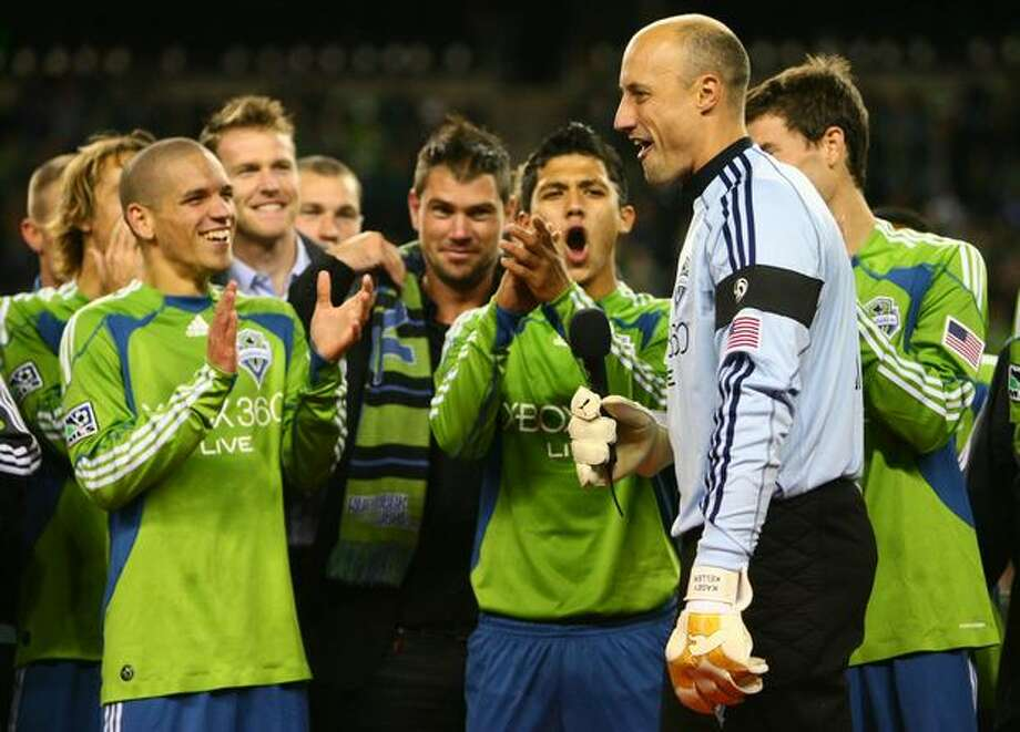 Seattle Sounders players gather around team captain and goalie Kasey Keller after the team defeated FC Dallas and ended regular season home games on Saturday October 24, 2009 at Qwest Field in Seattle. Photo: Joshua Trujillo, Seattlepi.com / seattlepi.com