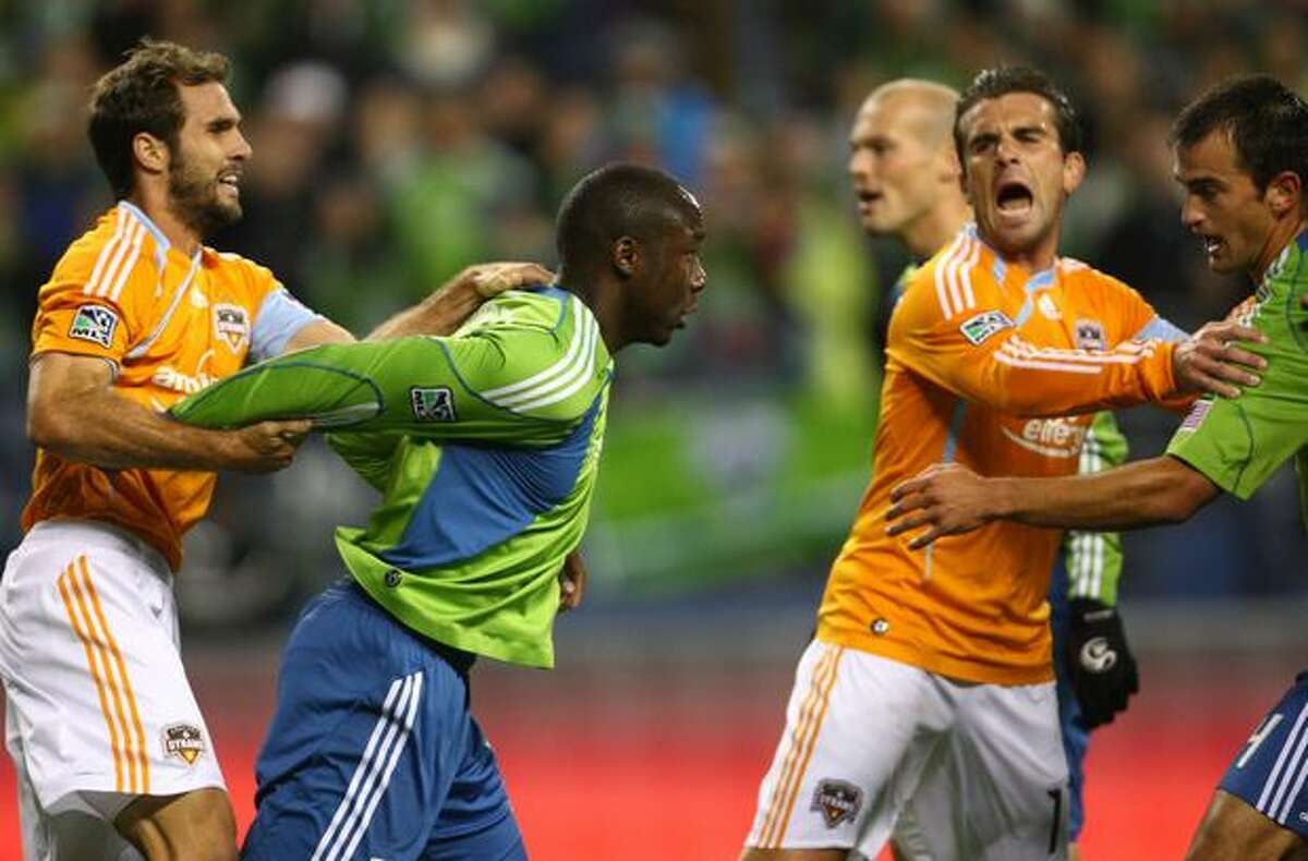 From left, Houston's Brian Mullan, Seattle's Jhon Kennedy Hurtado, Houston's Mike Chabala and Seattle's Patrick Ianni are involved in a pushing match that resulted in two yellow cards.