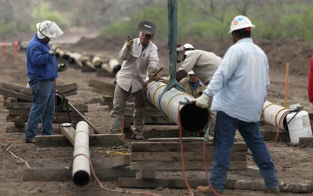 Welding crews are busy laying pipelines such as this one east of Karnes City, Texas in order to get oil and gas extracted from the Eagle Ford shale formation to market. Pipelines are critical because hauling by truck is more expensive. JOHN DAVENPORT/jdavenport@express-news.net Photo: JOHN DAVENPORT, SAN ANTONIO EXPRESS-NEWS / jdavenport@express-news.net