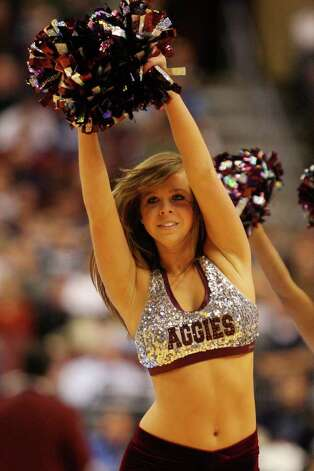 PHILADELPHIA - MARCH 21:  A Texas A&M Aggies cheerleader performs during the game against the Connecticut Huskies during the second round of the NCAA Division I Men's Basketball Tournament at the Wachovia Center on March 21, 2009 in Philadelphia, Pennsylvania. Photo: Jim McIsaac, Getty Images / 2009 Getty Images
