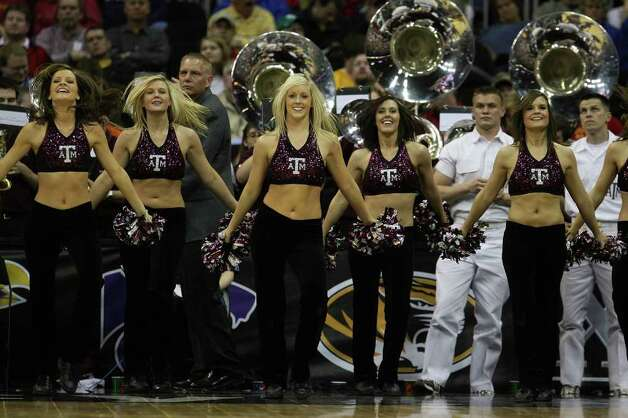 KANSAS CITY, MO - MARCH 13:  The Texas A&M Aggies cheerleaders dance on the sidelines during the game against the Iowa State Cyclones on day 1 of the Big 12 Men's Basketball Tournament on March 13, 2008 at the Sprint Center in Kansas City, Missouri. Photo: Jamie Squire, Getty Images / 2008 Getty Images