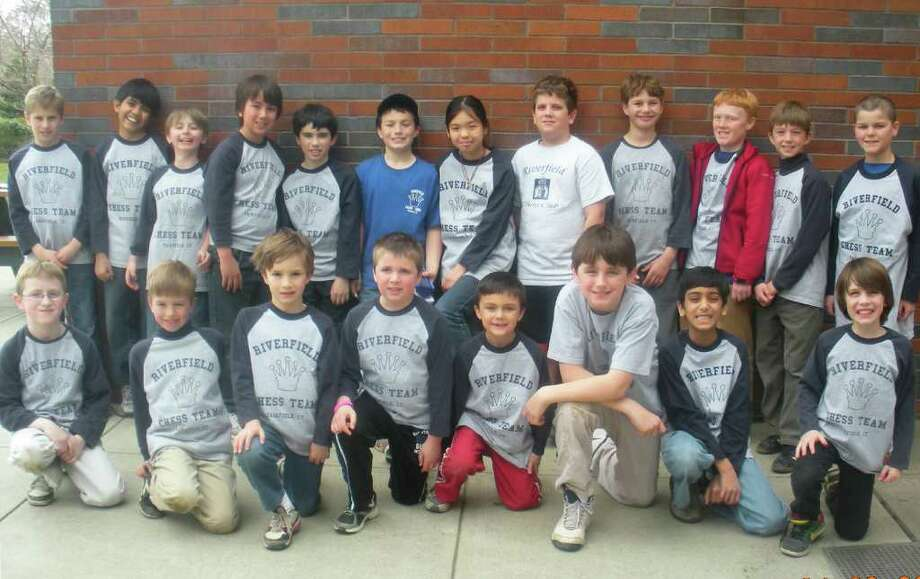 Riverfield Elementary School's chess team captured the Connecticut state championship title in two divisions at the Connecticut State Scholastic Chess Championships this past Saturday at Roger Ludlowe Middle School. Pictured are members of the victorious Riverfield Chess Team. In the back row, from left to right, are Sam Davenport, Rohan Butani, Malcolm Katz, Ryan Hummerstone, Sean Zentner, Greg Arrigo, Madison Lee, Austin Mascia, Justin Hallock, Jack Llewellyn, Joseph Santamaria and Johnny Blatt. In the front row, from left to right, are Danny McCarthy, Mark Santamaria, Alex Vlandis, Alex Bow, Matthew Booth, Jack McCarthy, Jaimin Vyas and Emmet Kells. Photo: Contributed Photo / Fairfield Citizen contributed