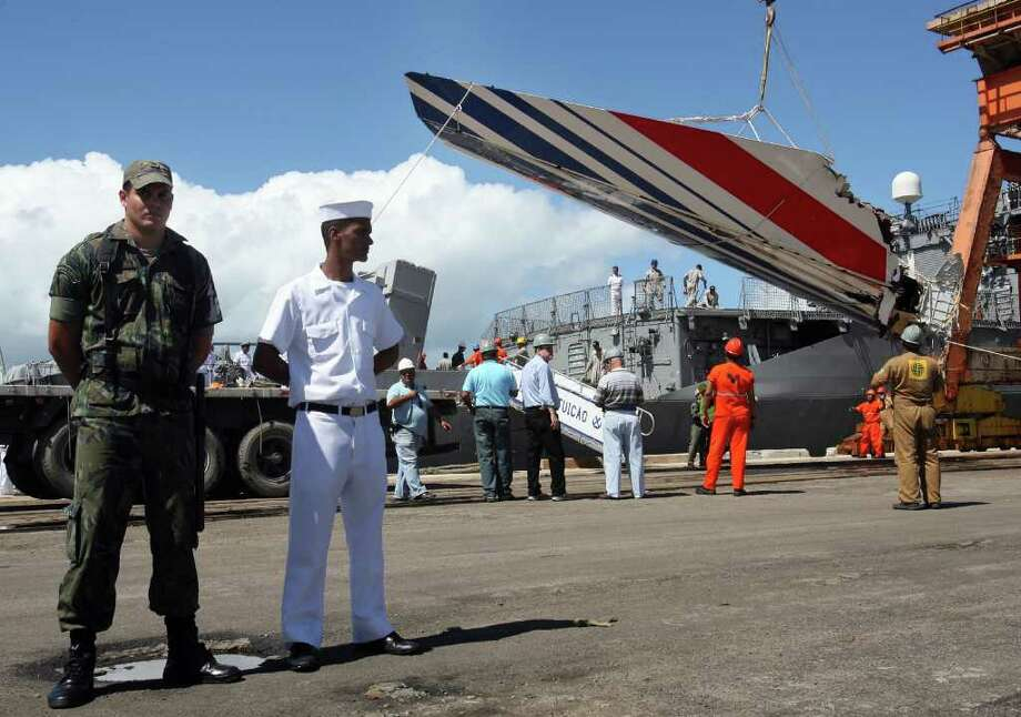 The recovered tailfin of the Air France A330 aircraft lost in midflight over the Atlantic ocean June 1st is unloaded from Brazilian Navy frigate Constituicao at Recife's harbor June 14, 2009. Debris recovered so far from Air France flight 447 seems to indicate the jet plunged suddenly into the Atlantic Ocean and did not explode in the sky, Brazilian experts said Saturday.  AFP PHOTO/Evaristo SA Photo: AFP/Getty Images