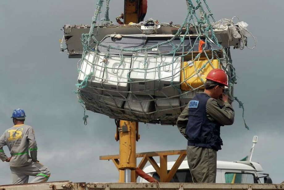 Recovered debris of the Air France aircraft lost in midflight over the Atlantic Ocean on June 1, 2009 is unloaded from a Brazilian Navy Corvette at Recife's harbor on June 19, 2009. Debris recovered so far from Air France flight 447 seems to indicate the jet plunged suddenly into the Atlantic Ocean and did not explode in the sky, Brazilian experts said. Photo: AFP/Getty Images