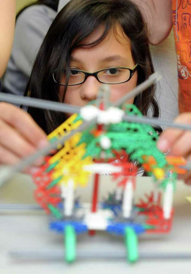 Margaret Kraus, 10, creates a helicopter during the hands-on portion of Saturday Academy, Inc.'s science festival at Norwalk Community College East Campus on Saturday, April 2, 2011. Photo: Lindsay Niegelberg / Connecticut Post