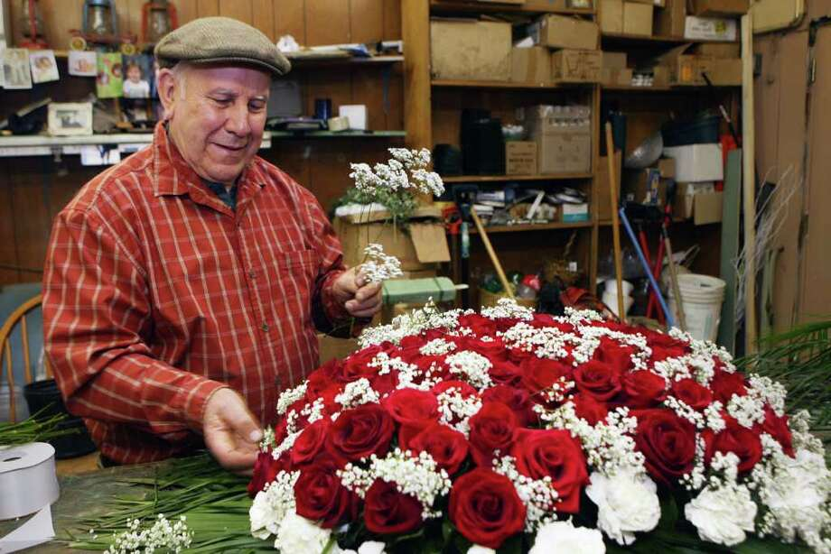 Ed Dillon Of Edward Sons Flower And Gift Prepares An Arrangement