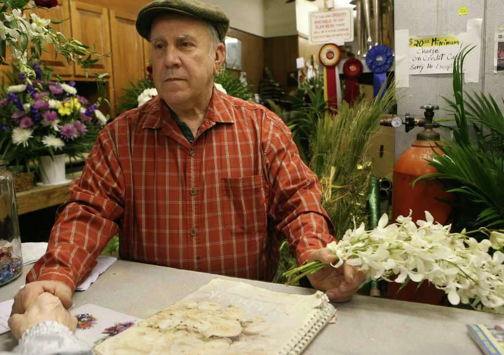 Ed Dillon Of Edward Sons Flower And Gift Helps A Customer