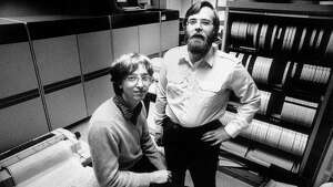 In 1981, computers the size of refrigerators and cabinets of tapes for reel-to-reel computer tape drives lined the walls in the small offices of Microsoft founders Bill Gates, left, and Paul Allen in Bellevue, Wash. In 1981 Microsoft employed 85 people. Since then Microsoft has moved to neighboring Redmond, Wash., and now employs 27,000 people. (AP Photo/Eastside Journal, Jim Hallas) MANDATORY CREDIT
