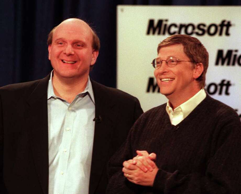 Steve Ballmer, left, and Microsoft founder Bill Gates beam for cameras at a hastily convened news conference Jan. 13, 2000, to announce that Ballmer has been named CEO of the software giant. (seattlepi.com file) Photo: PHIL H. WEBBER