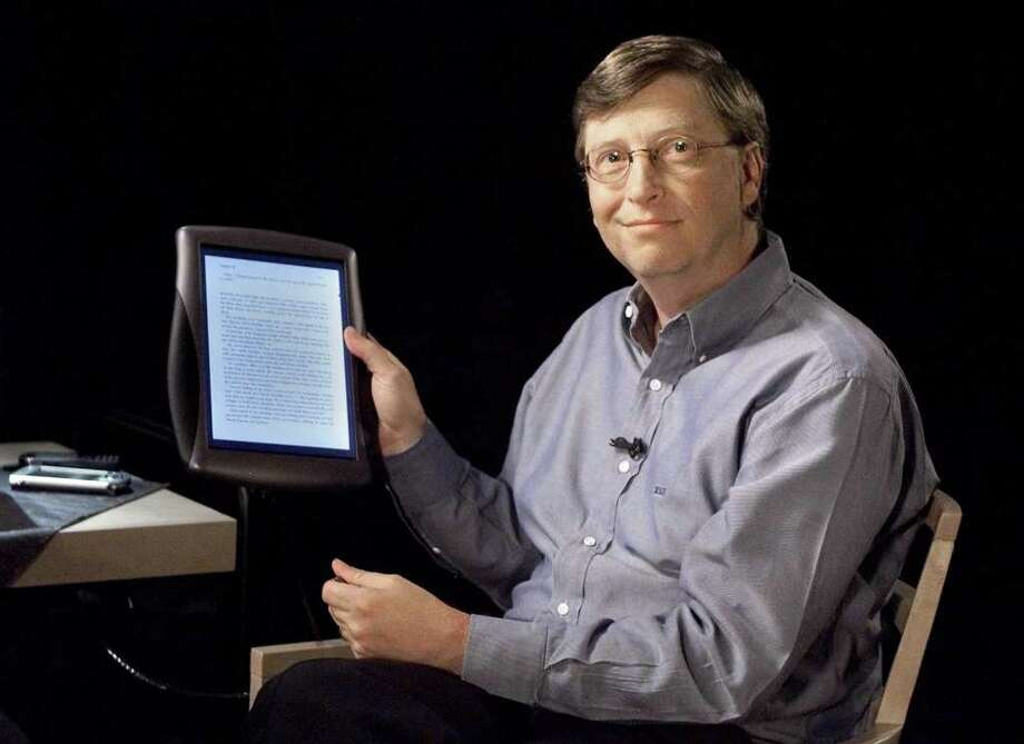 Bill Gates holds a tablet PC on June 22, 2000, at Microsoft's headquarters in Redmond. Microsoft introduced tablets a decade before Apple's iPad, but the software giant was never able to popularize them.  (AP Photo/Jeff Christensen) Photo: JEFF CHRISTENSEN, Associated Press / MICROSOFT