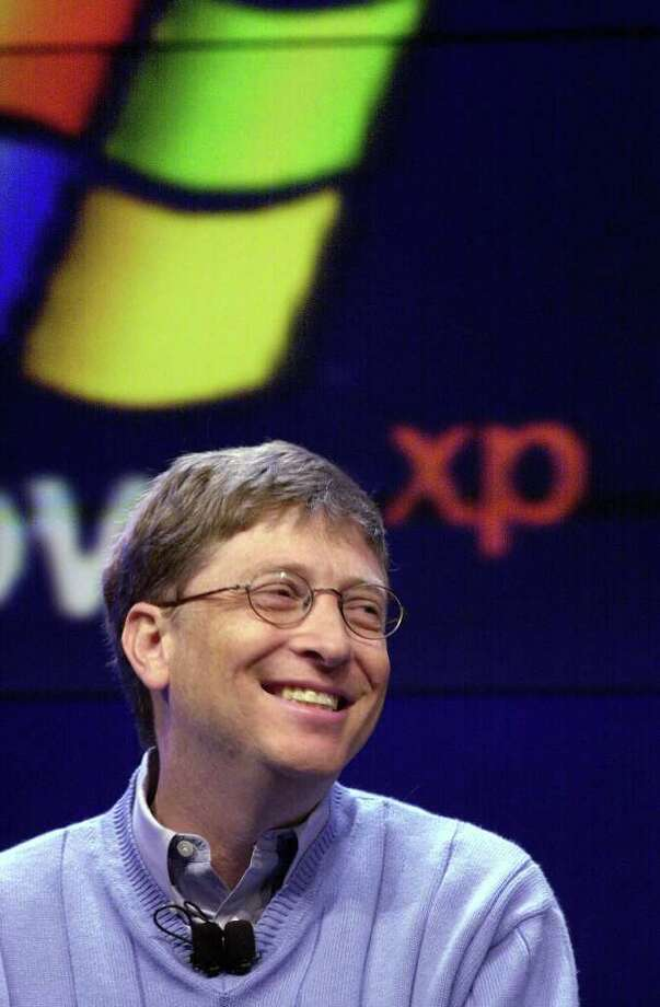 Bill Gates smiles during a news conference unveiling the company's newest operating system, Windows XP, on Feb. 13, 2001, in Seattle. (AP Photo/Elaine Thompson) Photo: ELAINE THOMPSON, Associated Press / AP