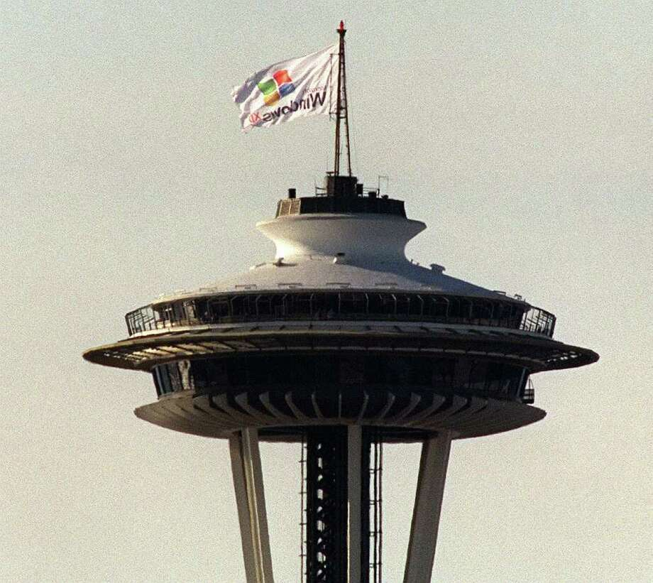 Microsoft pulled off another one of its publicity stunts by flying a flag from the Space Needle promoting Windows XP, more than 10 months before it was scheduled to be released. (seattlepi.com file) Photo: GRANT M. HALLER