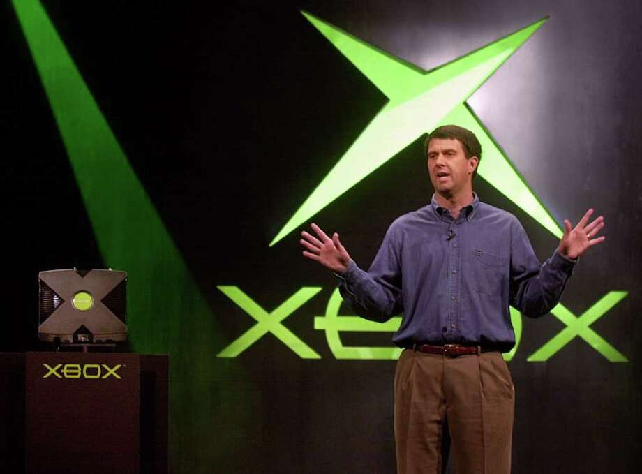 Robbie Bach, chief Xbox officer at Microsoft, gestures as he introduces the company's highly anticipated Xbox video game system at the Electronic Entertainment Expo in Los Angeles on May 16, 2001. Bach left the company in 2010. (AP Photo/Chris Pizzello) Photo: CHRIS PIZZELLO, Associated Press / AP