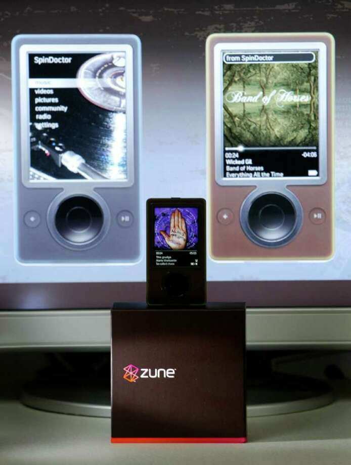 Microsoft showed off its new Zune music device on Sept. 14,  2006, in Redmond.  The device, to be released by the holiday season, competed with Apple's wildly popular iPod. (Joshua Trujillo/seattlepi.com file) Photo: Joshua Trujillo, Seattle Post-Intelligencer / Seattle Post-Intelligencer
