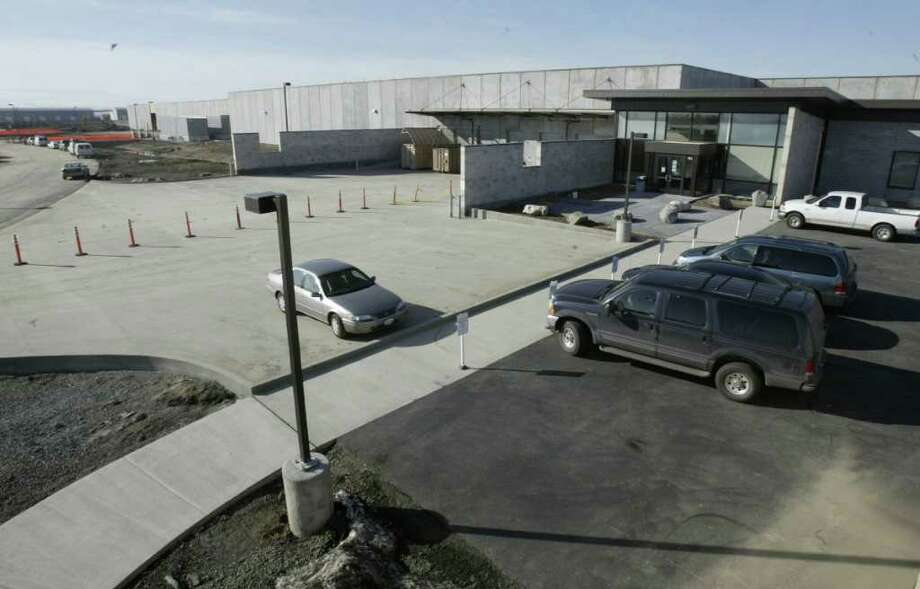 An employee entrance to the Microsoft Data Center in Quincy, Wash., is shown on March 6, 2007. Microsoft, Yahoo and Intuit were three the tech companies moving in to Quincy, an agriculturally driven town with inexpensive land and power. (seattlepi.com file) Photo: ANDY ROGERS, SEATTLE POST-INTELLIGENCER / SEATTLE POST-INTELLIGENCER