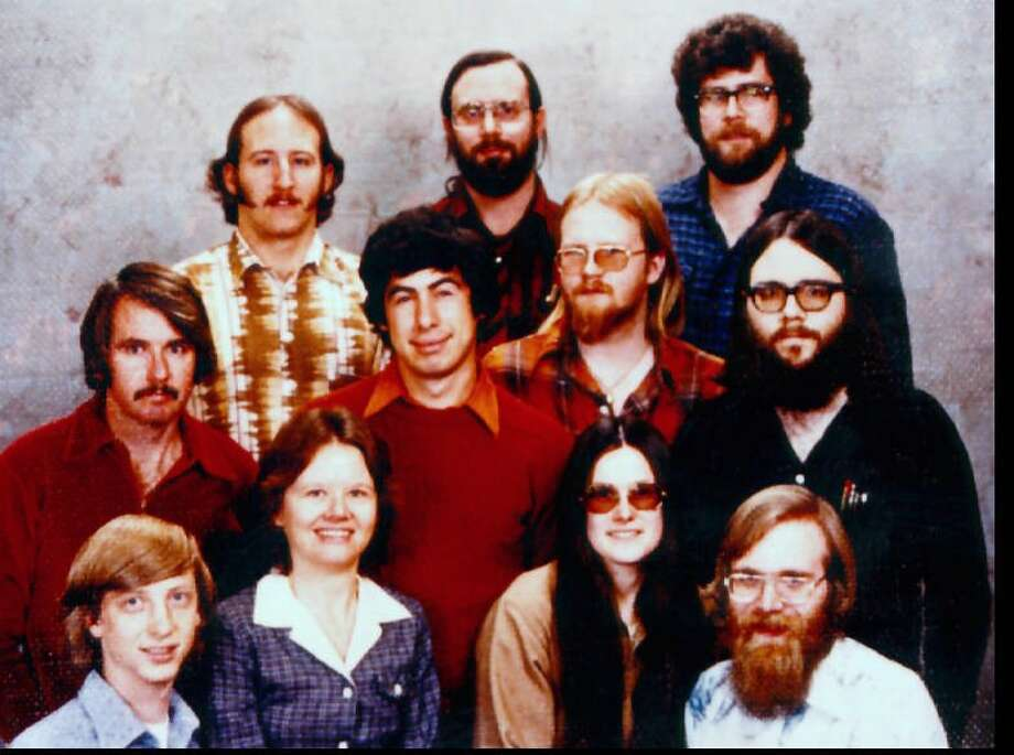 This famous photo, taken in 1978, shows the early Microsoft employees in  Albuquerque, before the company moved to Washington in 1979. Top row, left to right: Steve Wood, Bob Wallace and Jim  Lane. Middle: Bob O'Rear, Bob Greenburg,  Marc McDonald and Gordon Letwin. Bottom: Bill Gates,  Andrea Lewis, Marla Wood and Paul Allen. Photo: Seattlepi.com