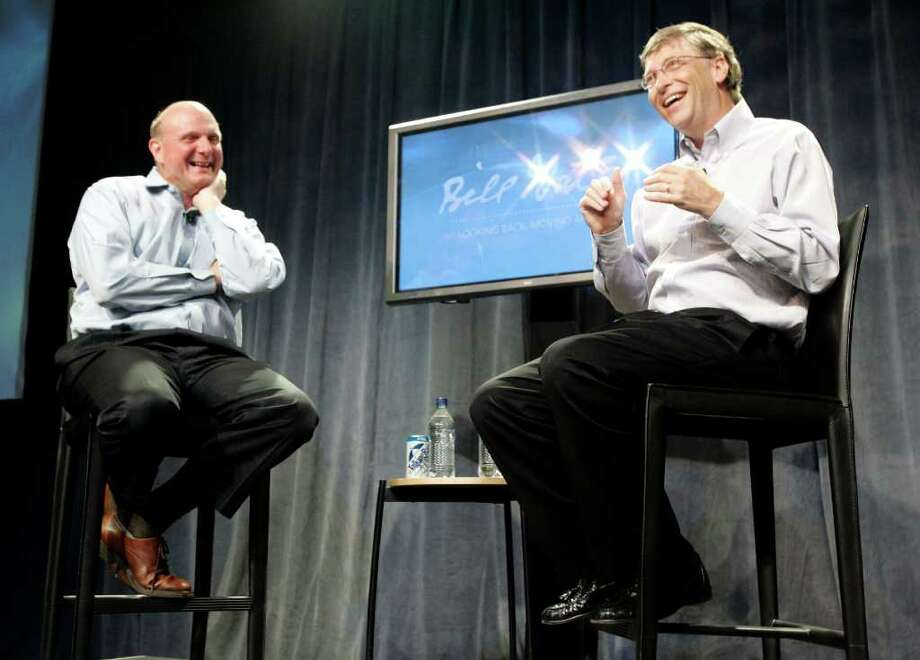 Bill Gates, right, speaks to employees as CEO Steve
