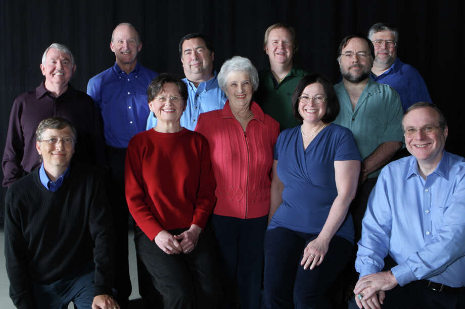 Microsoft recreated the photo in 2008. Pictured are: (back row, from left): Bob O'Rear, Steve Wood, Bob Greenberg, Marc McDonald,  Gordon Letwin and James Lane; (front row, from left) Bill Gates, Andrea Lewis, Miriam  Lubow, Marla Wood, Paul Allen. Bob Wallace, who was top center in the  original photo, died in 2002. Lubow, an early office manager, missed the 1978 photo. Photo: Seattlepi.com