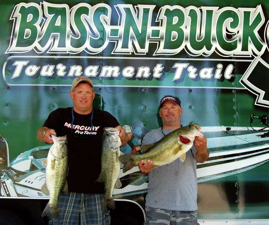 Clayton Boulware and Chris McCall won the Rayburn Bass N Bucks tournament with 24.25 lbs.  Chris also holds the Big Bass of the tournament weighing 8.08 lbs  Photo by Patty Lenderman / Lakecaster Managing Editor