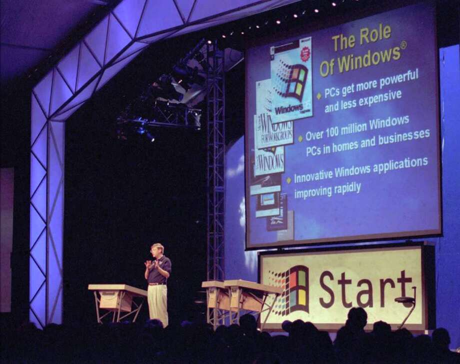 Bill Gates speaks before a giant screen at the Windows 95 launch event on Aug. 24, 1995, at the company's corporate campus in Redmond.  (AP Photo/Gary Stewart) Photo: Seattlepi.com