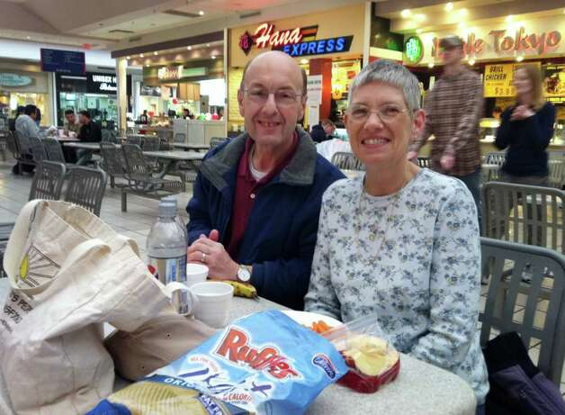 Karl and Rena Cooper, of Cobleskill, enjoy their own brownbag lunch at Crossgates Mall Monday morning April 4, 2011.  (Cathleen F. Crowley / Times Union) / Albany Times Union