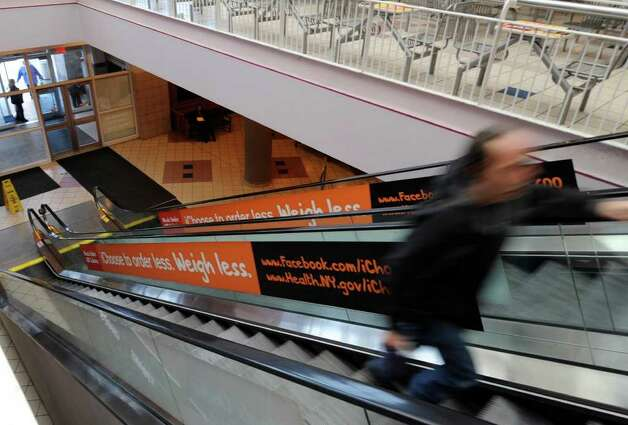 "Escalators near the food court at Crossgates Mall in Guilderland, N.Y. are adorned with ""I Choose 600"" obesity prevention campaign message as part of the local kick-off of National Public Health Week by Dr. Nirav R. Shah, New York State health commissioner, on April 4, 2011.  (Skip Dickstein / Times Union) Photo: Skip Dickstein / 2008"