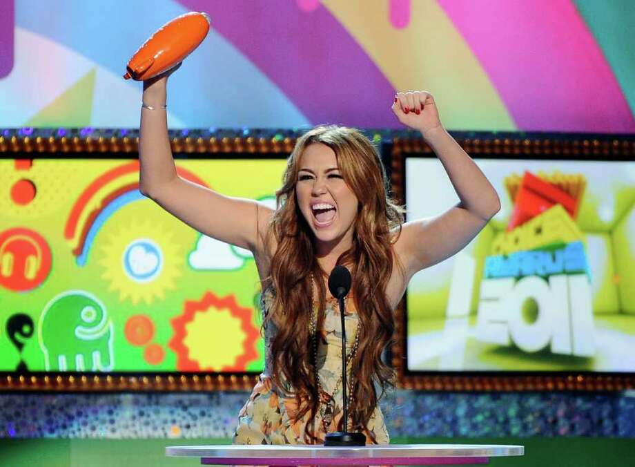 The family friendly Miley still showed up from time to time, such as at Nickelodeon's 24th Annual Kids' Choice Awards at Galen Center on April 2, 2011 in Los Angeles Photo: Kevork Djansezian, Getty Images / 2011 Getty Images