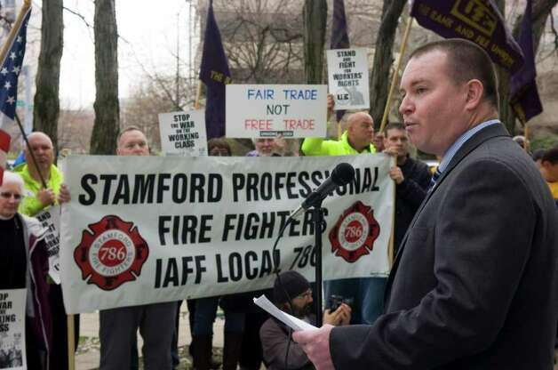 Stamford Professional Fire Fighters Association President Brendan Keatley addresses the crowd as United Electric workers, local 222 hold a rally in front of the Government Center to protest a proposal to cut pensions for all new city employees in Stamford, Conn., April 4, 2011. Photo: Keelin Daly / Stamford Advocate