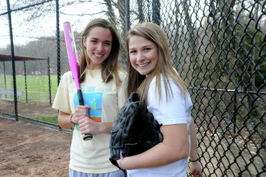 Greenwich High School softball team captains Barbara Callahan, 17, left, and Olivia Franchella, 17, at a practice at the school on April 4, 2011. Photo: Helen Neafsey / Greenwich Time