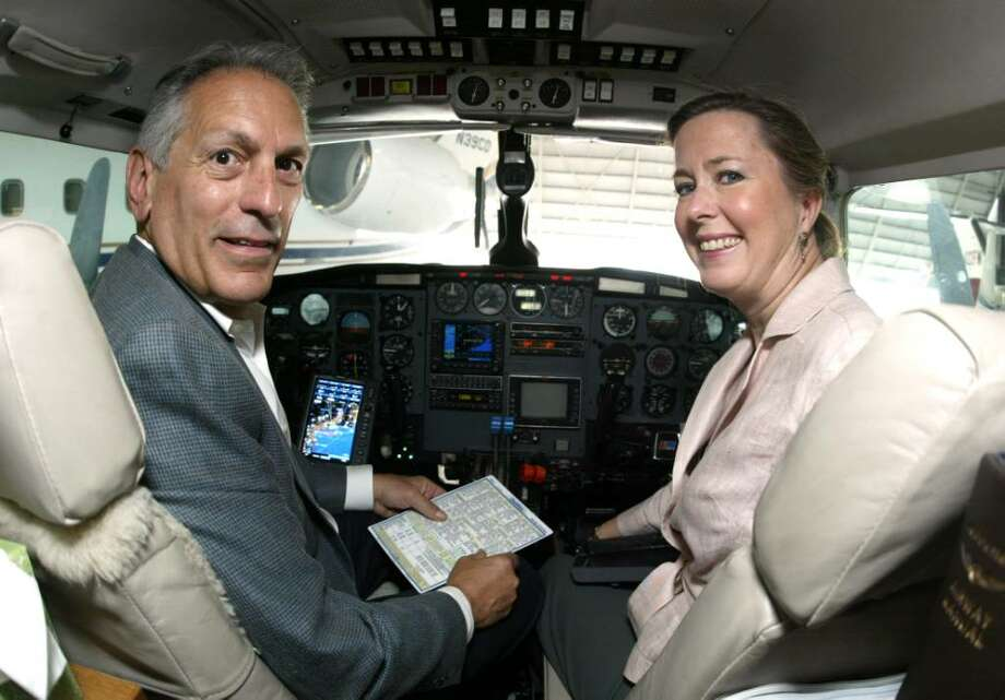 Captain Frank Bellocchio and Elizabeth Ball go over a checklist for Noreast Air's,  7 passenger, Piper Navajo Chieftain in Hanger 2 at Sikoprsky Airport in Stratford, Wednesday, Sept. 23, 2009. Photo: Phil Noel / Connecticut Post